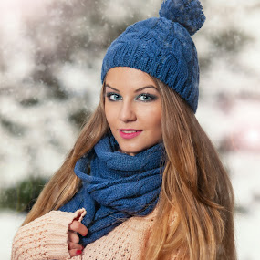 pretty young woman in a winter fashion shot by Iancu Cristi - People Portraits of Women ( seasonal, makeup, fairy, snowflake, feather, caucasian, sexy, cold, woman, flake, snow, lifestyle, glamorous, eye, cool, wild, xmas, happiness, forest, portrait, holiday, december, winter, eyelash, face, one woman only, model, fashion, clothing, joy, beauty, cute, pretty, glamor, fantasy, girl, attractive, happy, grey, glamour beauty, beautiful, christmas, expressing positivity, gloves, adult, young, princess, blue, female, elegant )