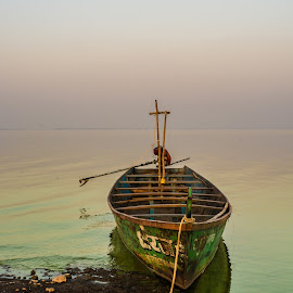 Lonely boat by Havneet Singh - Transportation Boats ( outdoor photography, waterscape, outdoors, outdoor, landscape photography, fishing, transportation, boat, waterscapes, landscapes, landscape, fishing boat )