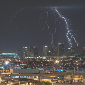 Two Bolts and the Phoenix Skyline by Bryan Snider - City,  Street & Park  Street Scenes ( airport, lightning bolts, skyline, lightning, desert, arizona monsoon, monsoon, thunderstorm, skyscrapers, sky harbor, arizona, buildings, weather, storms, phoenix, bolts,  )