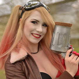 by Marco Bertamé - People Portraits of Women ( cosplay, gun, hair, goggles, blond, long, smile )