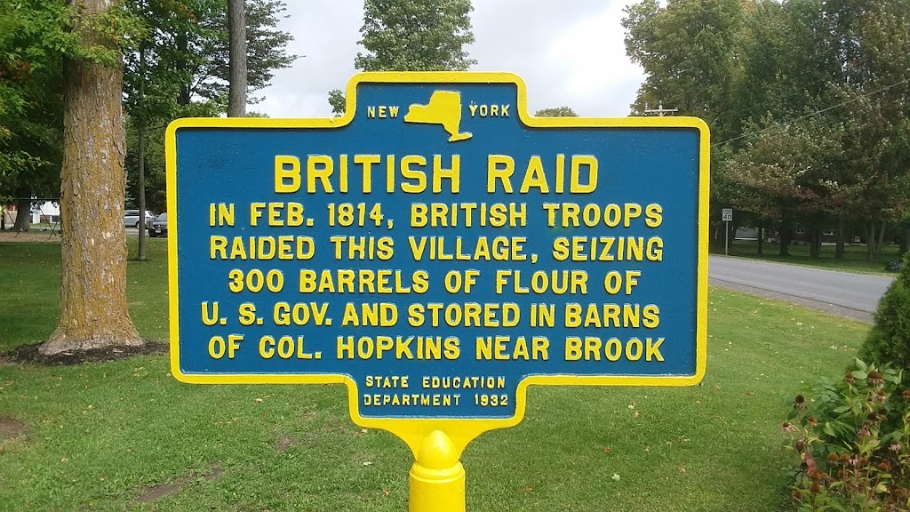 British RaidIn Feb. 1814, British troopsraided this village, seizing   300 barrels of flour ofU.S. Gov. and stored in barnsof Col. Hopkins near the brookState Education Department ...