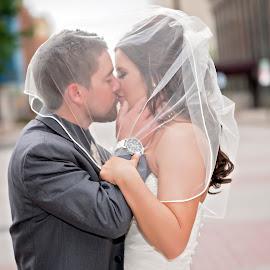 Passion by Carole Brown - Wedding Bride & Groom ( wedding, wedding veil, on street, wedding dress, ., bride and groom kissing )