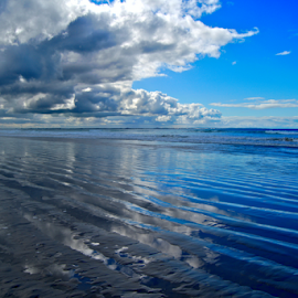 Low Tide at the Beach by Stefan Smit - Landscapes Waterscapes ( sand, reflection, blue, ocean, beach, clouds, water, sea,  )