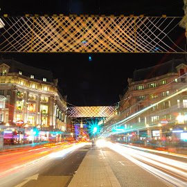 Christmas at Oxford Circus by DJ Cockburn - Public Holidays Christmas ( oxford circus, street, christmas, road, w1, motion blur, lights, junction, england, london, crossroads, holiday season, night, long exposure, decorations, oxford street, regent street, traffic lights, pavement )
