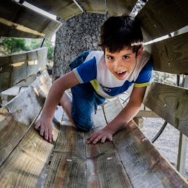 In the Tube v2 by Mladjan Pajkic - Babies & Children Child Portraits ( playing, wood, tube, game, smile, boy, kid )
