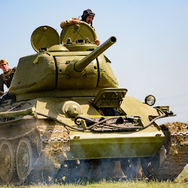 Russian Charge by Darrell Evans - Transportation Other ( old, wwii, grass, green, wheels, people, war, gun, military, history, flag, russian, transport, outdoor, men, warfare, tank, man )