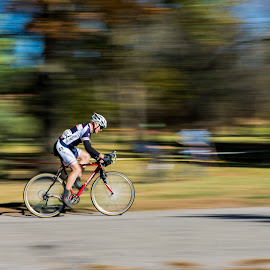 Spinning by Christopher Pischel - Sports & Fitness Cycling ( cyclist, panning, road race, cycling, motion, race, bicycle )
