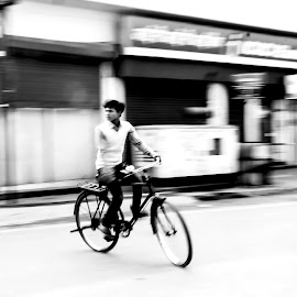 Cycling the Streets by Aritra Nath - Transportation Bicycles ( black and white, street, action, street photography, bicycle )