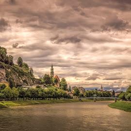 Salzburg by Ole Steffensen - City,  Street & Park  Vistas ( salzburg, church, salzkammergut, austria, river, clouds )