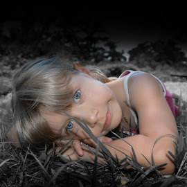 Girl in the grass by Iordan Daniel Teodorescu - Babies & Children Child Portraits ( girl, black and white, grass, blue eyes, children )