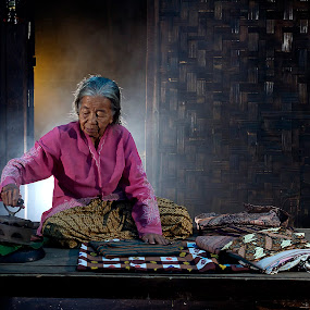 ironing by Nicholas Wibowo - People Portraits of Women ( senior citizen )