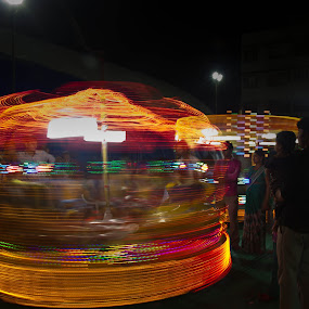Go round and round and round by Bhavik Patel - City,  Street & Park  City Parks