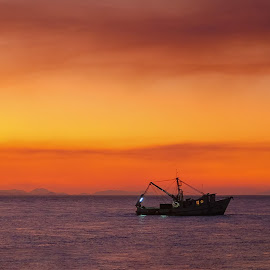 Done for the Day by Raymond Pauly - Landscapes Waterscapes ( seascape, coloured sky, ocean, golden hour, sunset, fishing boat, twilight )