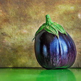 Eggplant by Kaye Menner - Food & Drink Fruits & Vegetables ( solanum melongena, kaye menner food, wood, cuisine, bench, kaye menner photography, chopping board, eggplant, botanical, solanaceae, kaye menner, photography, berry, green purple, ripe eggplant, guinea squash, brinjal, melongene, cooking, family solanaceae, aubergine, black, fruit, purple, green, brinjal eggplant, purple green, kitchen, board, wooden chopping board, kaye menner fruit and vegetables, kitchen bench, food, nightshade, green bench,  )