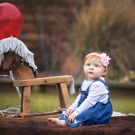 Chloe turns 1 by Jeannie Meyer - Babies & Children Child Portraits ( canon, cowgirl, wooden horse, cowhide, pink, red head )