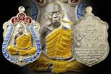 เหรียญเสมาคูณสิบทิศหลวงพ่อคุณ ปริสุทโธ เนื้อเงินหน้ากากเงิน ขอบเงิน ลงยา 3 สี