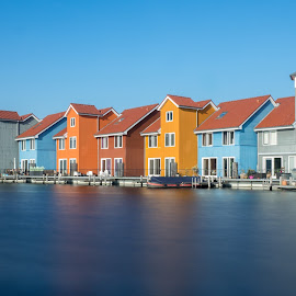 Dominant Blue by Martijn van Sabben - Buildings & Architecture Homes ( water, cool, home, houses, blue, house, homes, shot, city, long exposure. )
