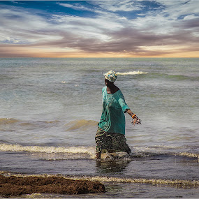 End of the Day by Stephen Hooton - Uncategorized All Uncategorized ( water, gambia, waterscape, female, fish, fishing )