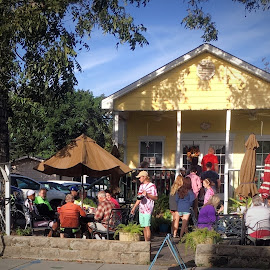 Breakfast At the Buttercup Cafe by Eric Michaels - Buildings & Architecture Other Exteriors ( building, restaurant, morning, people, women, bicycle, mississippi, sunny, trees, sunshine, men, waiter, buttercup cafe, bay st. louis )