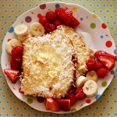 Worlds Best Coconut Crusted French Toast with Bananas and Berries