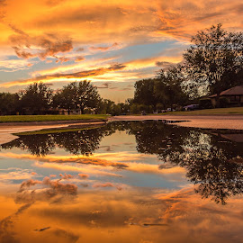 Colorfully Reflective street by Kathy Suttles - City,  Street & Park  Street Scenes ( street art, oklahoma sky, street reflections, orange dusk, after the storm, street puddle reflections )
