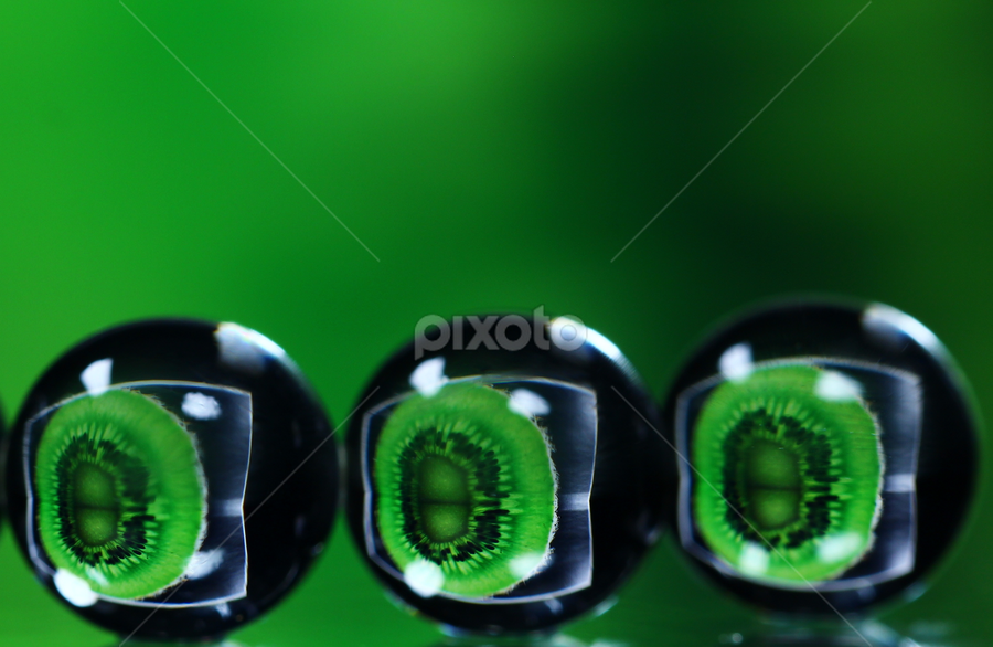 Balls reflecting kiwi fruit. by Dipali S - Abstract Macro ( balls, reflection, food, green, kiwi fruit, vegetable )