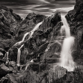 Flow in Greyscale by Darrell Evans - Landscapes Waterscapes ( water, clouds, stream, grass, brook, green, cliff, stone, flow, landscape, close-up, close, sky, nature, yorkshire, flood, outdoor, cliff-face, wet, rivulet, bolder, closeup, river )