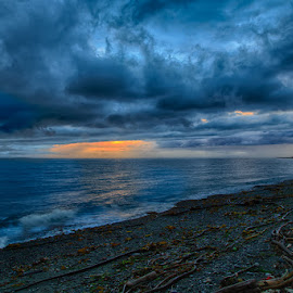 Stormy Sunset by Briand Sanderson - Landscapes Beaches ( washington state, storm front, whidbey island, sunset, beach, storm, united states )