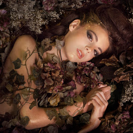 Overgrown Beauty by Patricia Wouterse - Babies & Children Child Portraits ( bronze, glamour, brown eyes, girl, beautiful, flowers, young, darkness )