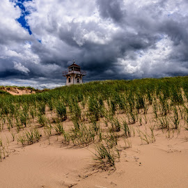 Lighthouse by Vernie Gillespie - Landscapes Beaches ( clouds, sand, grass, lighthouse, beach )