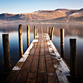 Pier at Derwent Water by Pete Barnes - Landscapes Waterscapes ( water, calm, reflection, uk, derwent, frost, lakes, still, jetty, derwent water, lake district, mountains, cold, pier, scene, frosty )
