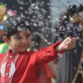 Festival... by Sofia Zaman - Babies & Children Children Candids ( playing, natural light, red, colors, bubbles, child portrait, smiling )