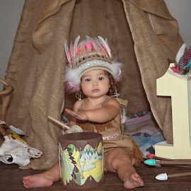 One by Carole Brown - Babies & Children Babies ( curly brown hair, brown eyes, indian headress, cute, one year old girl )