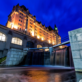 Chateau Laurier Hotel by James Wheeler - City,  Street & Park  Historic Districts ( nobody, can, bright, colorful, waterfall, architecture, cityscape, travel, capital, historic, heritage, city, lights, adventure, laurier, downtown, sightseeing, water, building, canada, national, rideau, ottawa, tourism, ontario, canal, unesco, destination, history, holiday, landmark, tower, outdoor, canadian, castle, night, historical, hotel, chateau, outside, river, waterway )