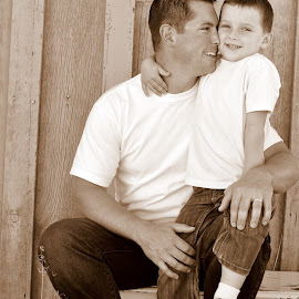 Jessica Hadfield, thought I would surprise you with my favorite photo from our shoot, actually one of my favorites of a father and son in a long while that I have taken. I just love this one of Nathan Hadfield and Brady.  I will have all your edited pics on a cd for you Thursday! I stayed up late and got them done. by Jodie Lindbo - People Family