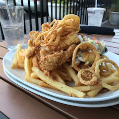 Fried fish and chips with onion straws