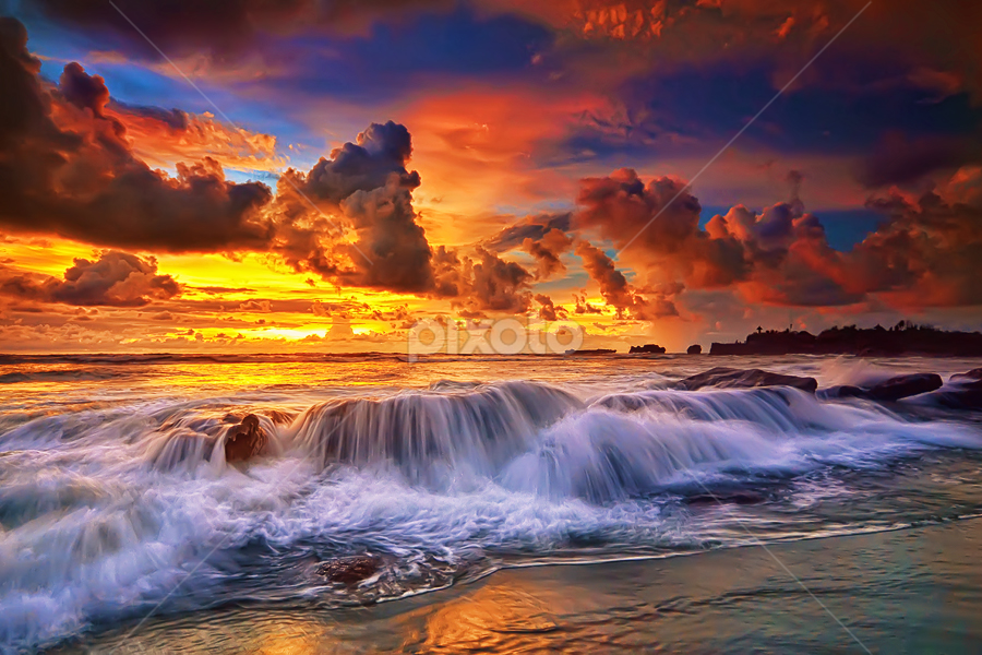 On a rocky beach by Hendri Suhandi - Landscapes Waterscapes ( shore, bali, sunset, sea, rock, beach, motion )