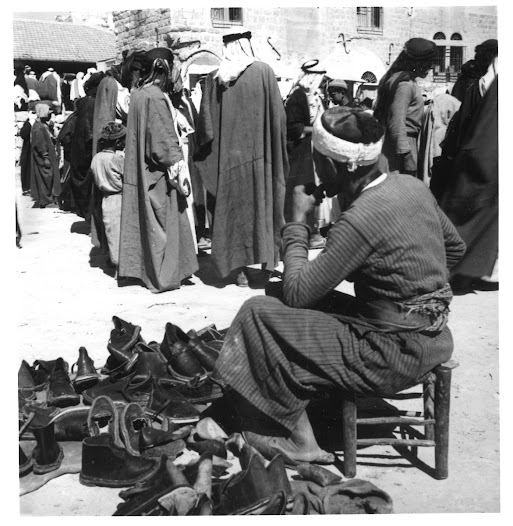 A shoemaker selling his wares in Bethlehem market, Palestine, 1930s. Photo: Jan Macdonald.