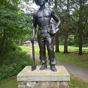 THE C.C.C. WORKER THIS STATUE IS DEDICATED TO THE YOUNG MEN WHO SERVED IN THE CIVILIAN CONSERVATION CORPS FROM 1933 TO 1942. THEIR WORK IN THE PARKS AND FORESTS OF WISCONSIN AND MANY OTHER STATES, ...