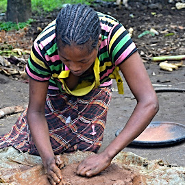 A Potter. by Marcel Cintalan - People Street & Candids ( simple, potter, hairstyle, young girl, ethiopia,  )