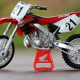 Toy Bike by Ashish Daga - Artistic Objects Toys ( red and white, honda, bike, zoom, motorcycle, blur, blurry )