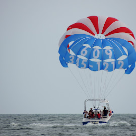 Parachute ride. by Sangeetha Selvaraj - Transportation Other ( ride, sea, boat, parachute, KidsOfSummer )