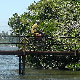 Bridge to most populated island in the river system.  Couple hundred people live here. by Kevin Bittner - Transportation Bicycles
