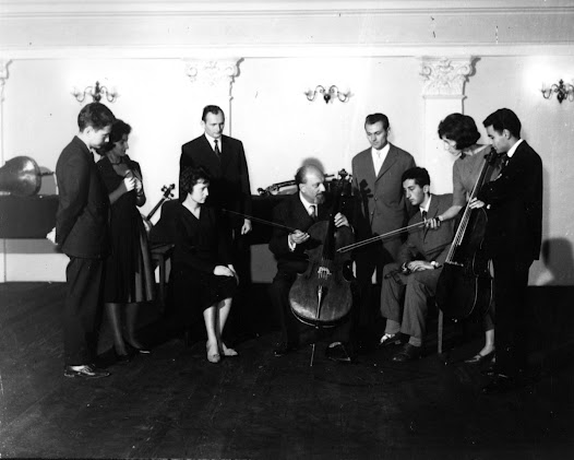 Matz speaks with a group of cello students around 1960.