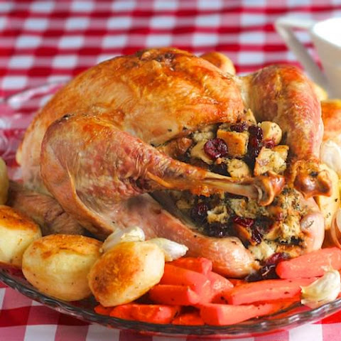 Turkey Basted in Roasted Garlic Sage Butter with Cranberry Herb Stuffing