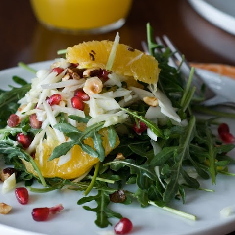 Orange Fennel Arugula Salad with Pomegranates and candied Hazelnuts
