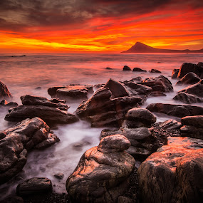 Sunrise on the Hornstrandir Coast by Derek Kind - Landscapes Waterscapes ( icelandic, clouds, water, mountain, rocky, mordor, beach, sunlight, sun, iceland, sunset, dramatic, 2012, long exposure, derek kind, sunrise, rocks, foam )