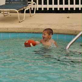 Playing football in pool! by Terry Linton - Babies & Children Children Candids