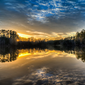Sunset Mirror by Brian Young - Landscapes Waterscapes ( clouds, water, reflection, sky, sunset, trees, lake, pond, sun )