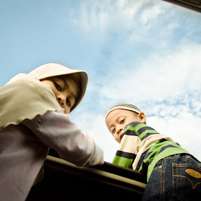 Sky Is The Limit by Muhammad Taslim Mohd Razin - Babies & Children Children Candids ( muslim, girl, 2011, children, malaysia, cutes, kopiah, hijab, sky is limit reahing the sky jeans blue green, boy )
